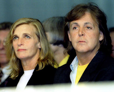 Linda and Paul McCartney watch their daughter Stellas designs being modelled at the Central Saint M..