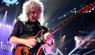 Brian May (Queen) explica el curioso motivo por el que toca con una moneda y no con una púa